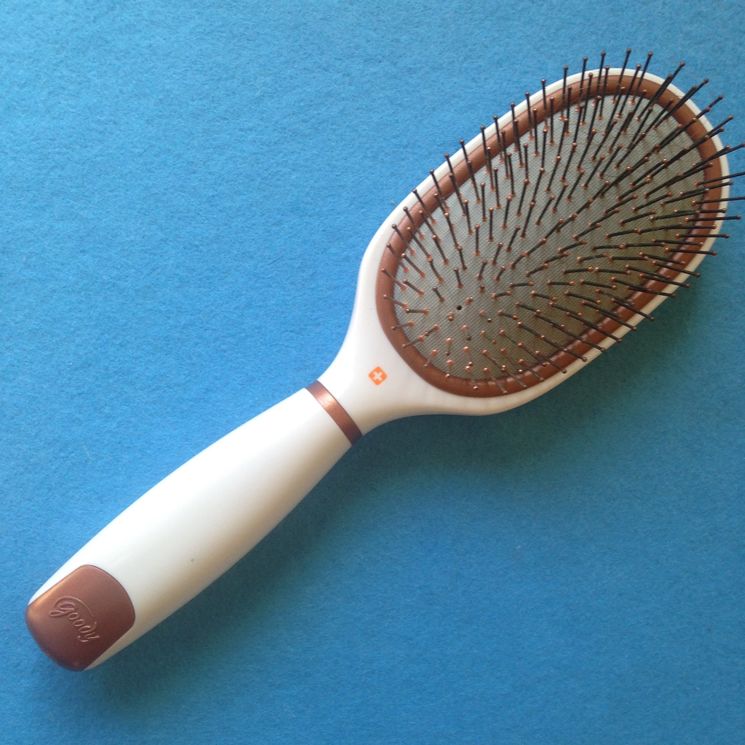 how to clean dandruff from hair brush